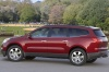 2011 Chevrolet Traverse LTZ in Red Jewel Tintcoat from a rear left three-quarter view