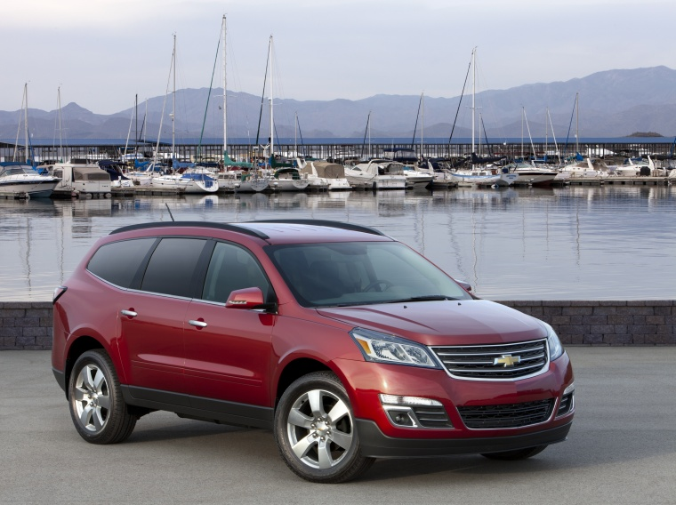 2013 Chevrolet Traverse LTZ AWD in Crystal Red Tintcoat from a front right three-quarter view