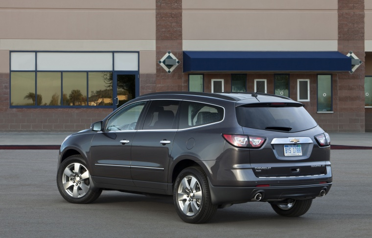 2013 Chevrolet Traverse LTZ AWD in Black Granite Metallic from a rear left three-quarter view