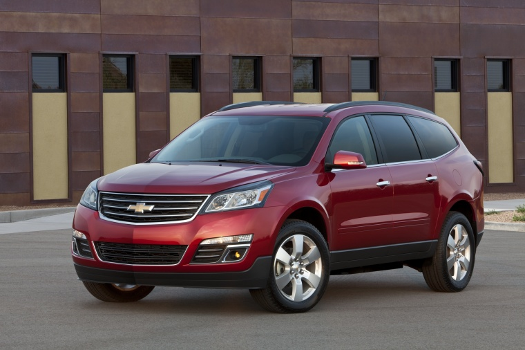 2014 Chevrolet Traverse LTZ AWD in Crystal Red Tintcoat from a front left three-quarter view