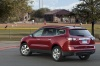 2014 Chevrolet Traverse LTZ AWD in Crystal Red Tintcoat from a rear left three-quarter view