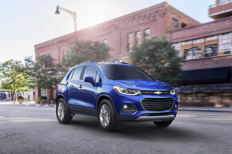 Driving 2020 Chevrolet Trax Premier in Blue from a front right three-quarter view