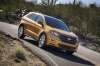Driving 2016 Ford Edge Sport in Electric Spice Metallic from a front right view
