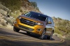 Driving 2016 Ford Edge Sport in Electric Spice Metallic from a front left view