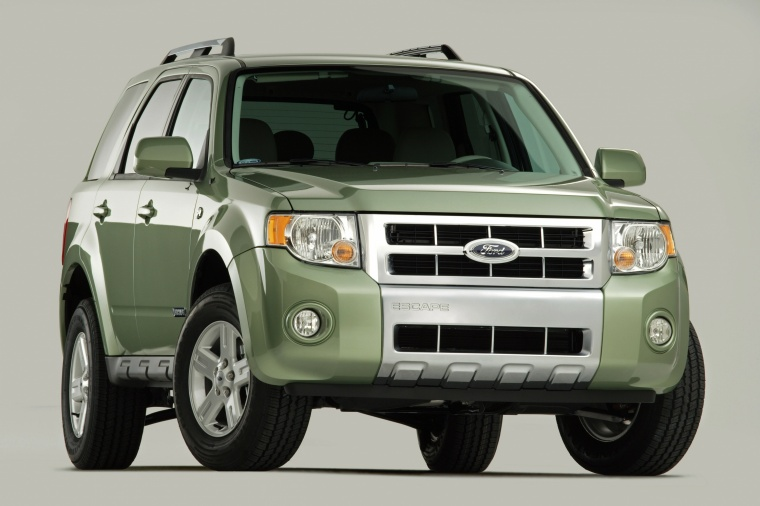 2011 Ford Escape Hybrid in Kiwi Green Metallic from a front right view