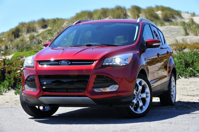 2016 Ford Escape Titanium 4WD in Ruby Red Tinted Clearcoat from a front left view