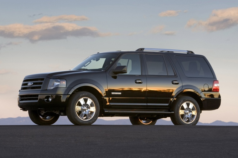 2011 Ford Expedition in Tuxedo Black Metallic from a left side view