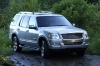 Driving 2010 Ford Explorer in Brilliant Silver Metallic from a front right three-quarter view