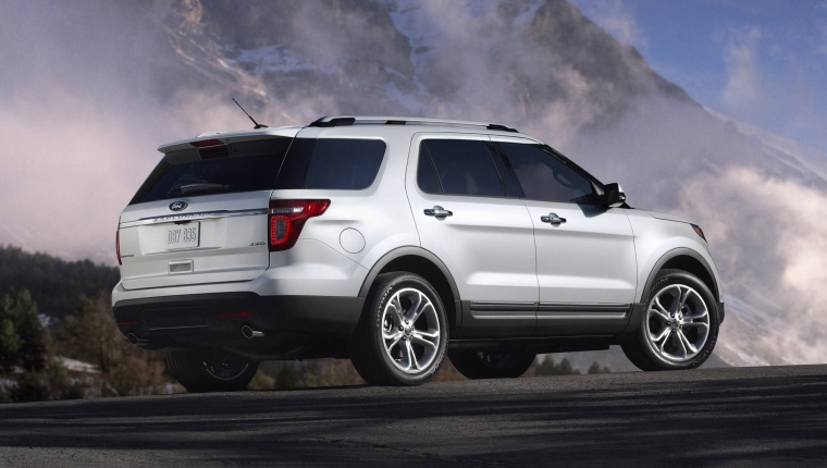2013 Ford Explorer Limited 4WD in White Suede from a rear right three-quarter view