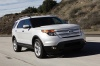 Driving 2013 Ford Explorer Limited 4WD in Ingot Silver Metallic from a front right view