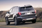 2019 Ford Explorer Platinum 4WD in Magnetic Metallic - Driving Rear Left View