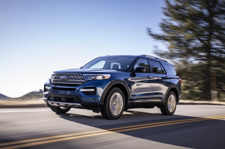 Driving 2020 Ford Explorer Limited in Atlas Blue Metallic from a front left view