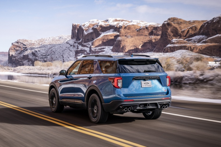 Driving 2020 Ford Explorer ST EcoBoost 4WD in Atlas Blue Metallic from a rear left view