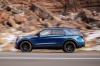 Driving 2020 Ford Explorer ST EcoBoost 4WD in Atlas Blue Metallic from a left side view