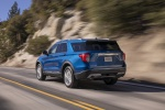 2020 Ford Explorer Limited in Atlas Blue Metallic - Driving Rear Left View
