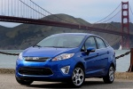 2013 Ford Fiesta Sedan in Blue Candy Metallic Tinted Clearcoat - Static Front Left View