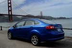 2013 Ford Fiesta Sedan in Blue Candy Metallic Tinted Clearcoat - Static Rear Left View