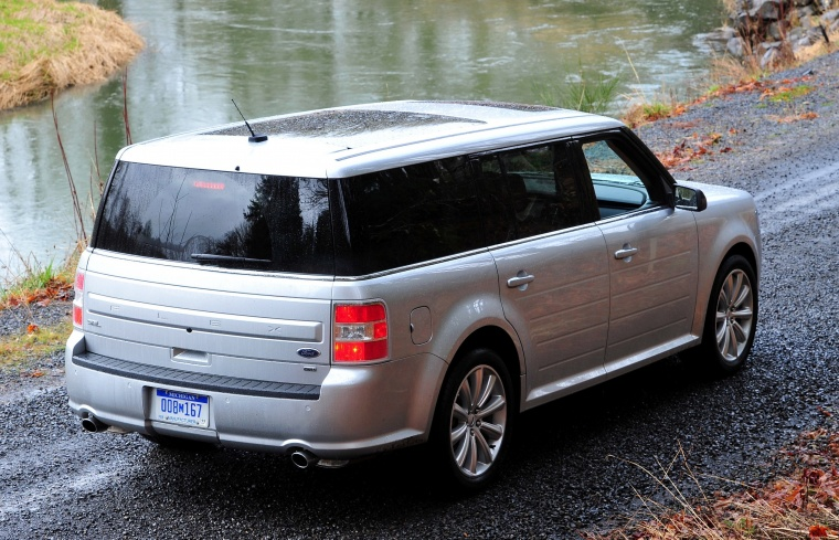 2014 Ford Flex SEL in Ingot Silver Metallic from a rear right three-quarter view