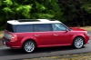 Driving 2016 Ford Flex SEL in Ruby Red Metallic Tinted Clearcoat from a rear right three-quarter view