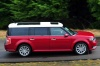 Driving 2016 Ford Flex SEL in Ruby Red Metallic Tinted Clearcoat from a right side view