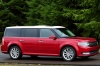 Driving 2016 Ford Flex SEL in Ruby Red Metallic Tinted Clearcoat from a front right three-quarter view