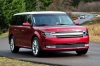 Driving 2016 Ford Flex SEL in Ruby Red Metallic Tinted Clearcoat from a front right view