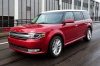 Driving 2016 Ford Flex SEL in Ruby Red Metallic Tinted Clearcoat from a front left view