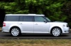Driving 2016 Ford Flex SEL in Ingot Silver Metallic from a right side view