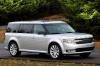 Driving 2016 Ford Flex SEL in Ingot Silver Metallic from a front right three-quarter view