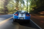 2010 Shelby GT500 Coupe in Grabber Blue - Driving Rear View