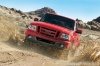 Driving 2011 Ford Ranger in Torch Red from a frontal view