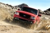 Driving 2011 Ford Ranger in Torch Red from a front left view