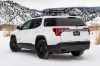 2020 GMC Acadia AT4 AWD in Summit White from a rear left three-quarter view