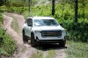 Driving 2020 GMC Acadia AT4 AWD in Summit White from a front right view