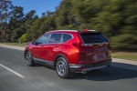 2019 Honda CR-V Touring AWD in Molten Lava Pearl - Driving Rear Left Three-quarter View