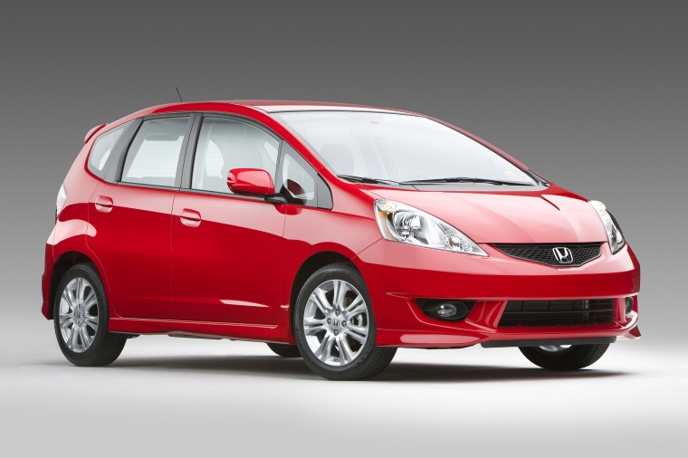 2010 Honda Fit Sport in Milano Red from a front right three-quarter view