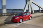 2010 Honda Fit in Milano Red - Driving Front Left Three-quarter View
