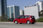 2010 Honda Fit in Milano Red - Driving Rear Left Three-quarter View