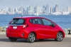 2017 Honda Fit in Milano Red from a rear right three-quarter view