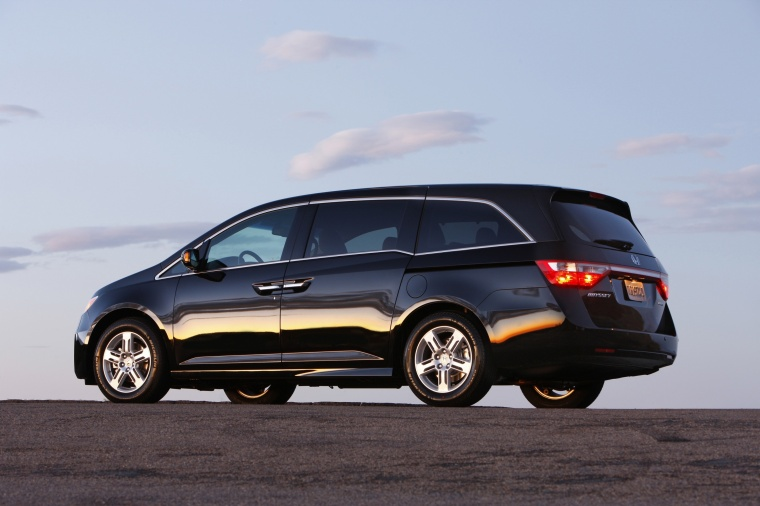 2011 Honda Odyssey Touring in Crystal Black Pearl from a rear left three-quarter view