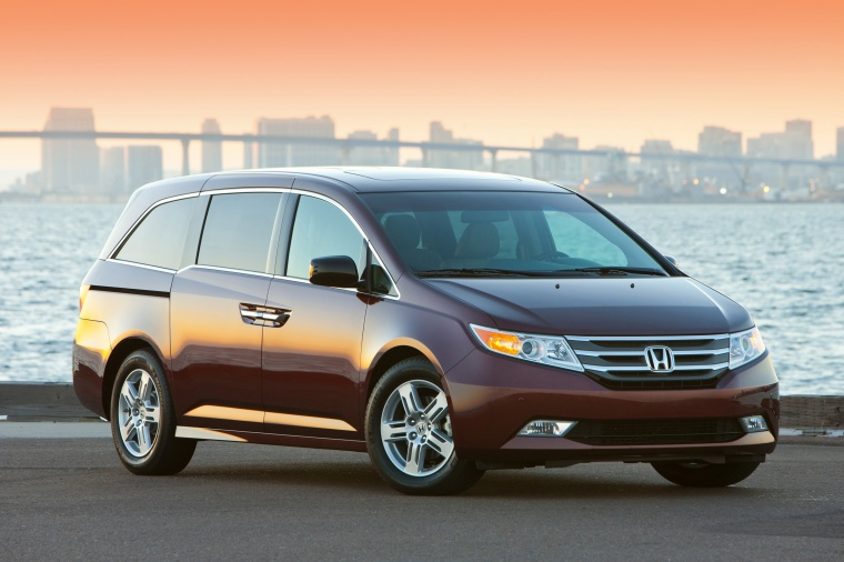 2011 Honda Odyssey Touring in Dark Cherry Pearl from a front right view