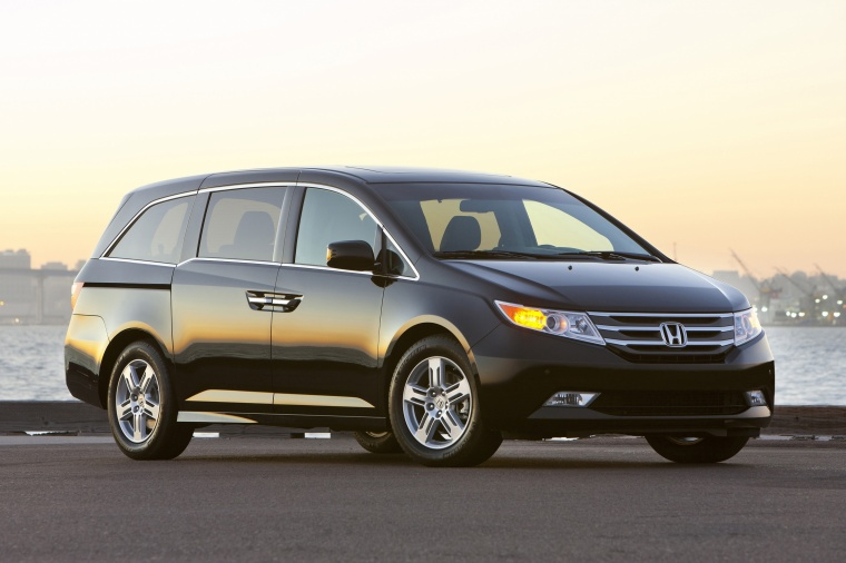 2011 Honda Odyssey Touring in Crystal Black Pearl from a front right three-quarter view