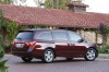 2011 Honda Odyssey Touring in Dark Cherry Pearl from a rear right three-quarter view