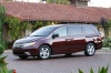 2011 Honda Odyssey Touring in Dark Cherry Pearl from a front left three-quarter view