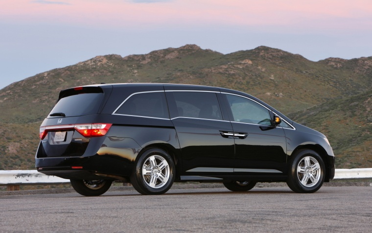2012 Honda Odyssey Touring in Crystal Black Pearl from a rear right three-quarter view