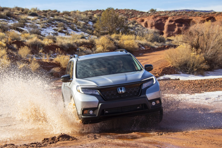 Driving 2020 Honda Passport Elite AWD in Lunar Silver Metallic from a frontal view