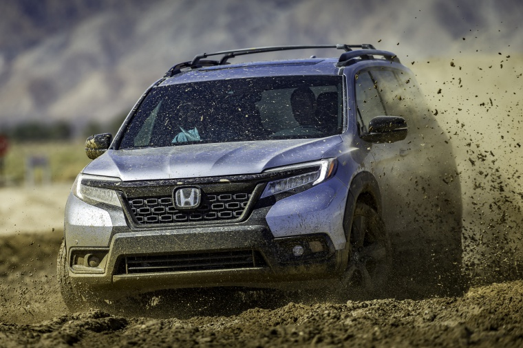 Driving 2020 Honda Passport Elite AWD in Lunar Silver Metallic from a front left view