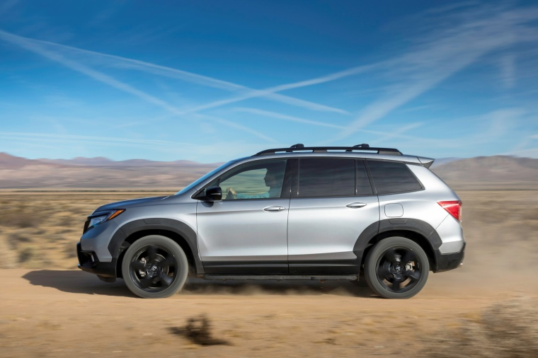 Driving 2020 Honda Passport Elite AWD in Lunar Silver Metallic from a left side view