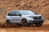 Driving 2020 Honda Passport Elite AWD in Lunar Silver Metallic from a front right three-quarter view