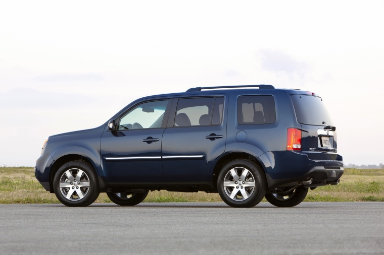 2013 Honda Pilot Touring in Obsidian Blue Pearl from a rear left three-quarter view
